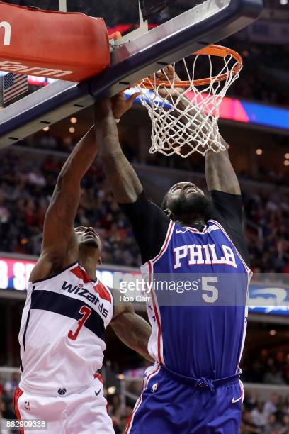 Bradley Beal of the Washington Wizards fouls Amir Johnson of the Philadelphia 76ers in the first half at Capital One Arena on October 18 2017 in...