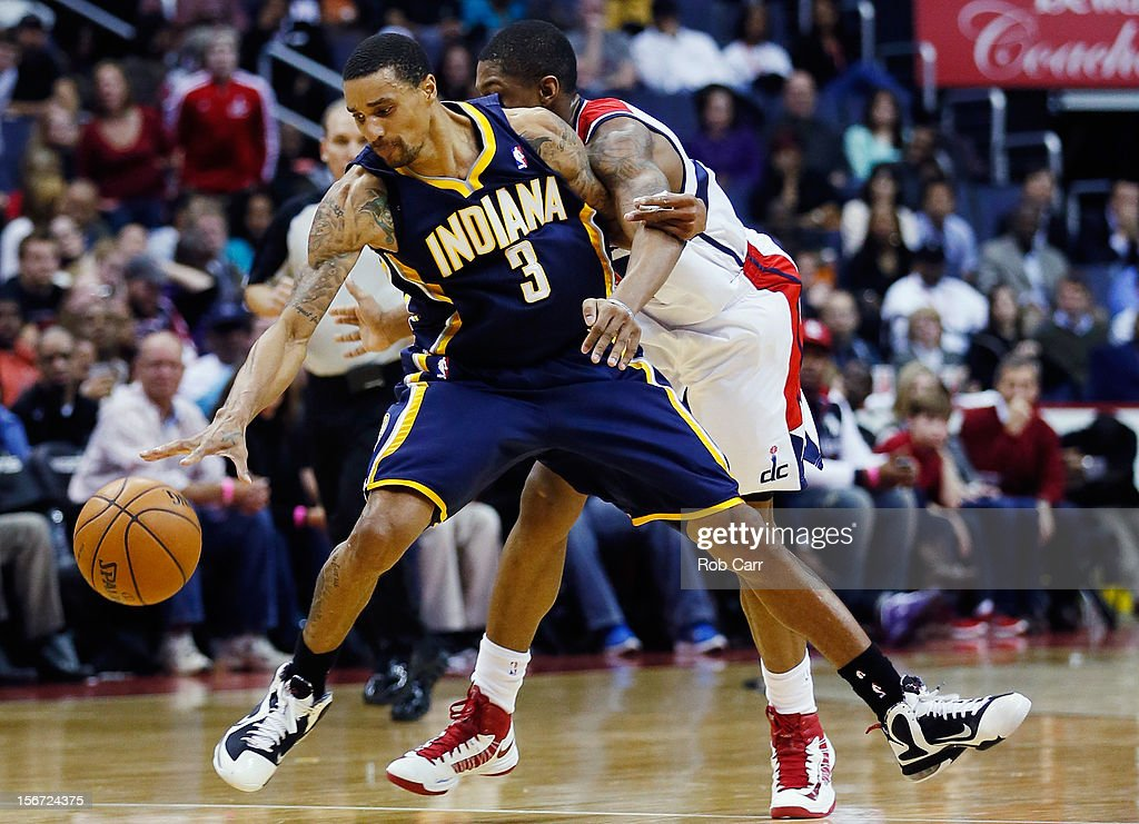 <a gi-track='captionPersonalityLinkClicked' href=/galleries/search?phrase=Bradley+Beal&family=editorial&specificpeople=7640439 ng-click='$event.stopPropagation()'>Bradley Beal</a> #3 of the Washington Wizards fouls George Hill #3 of the Indiana Pacers during the second half of the Pacers 96-89 win at Verizon Center on November 19, 2012 in Washington, DC.