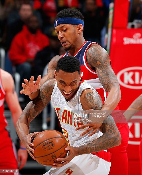 Bradley Beal of the Washington Wizards fouls Jeff Teague of the Atlanta Hawks at Philips Arena on March 21 2016 in Atlanta Georgia NOTE TO USER User...