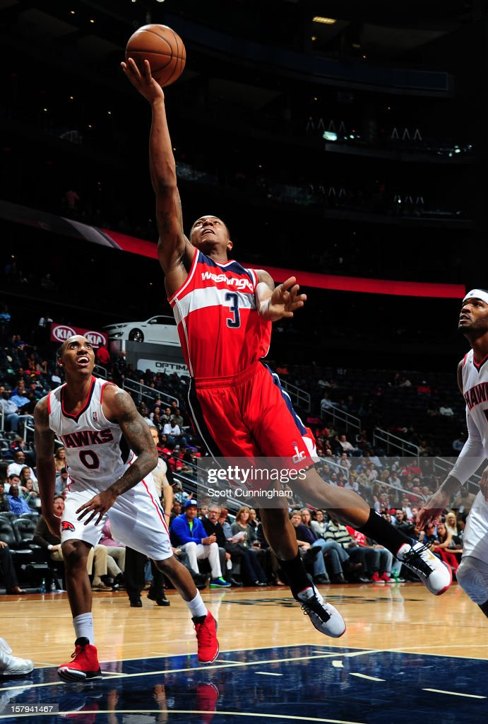 <a gi-track='captionPersonalityLinkClicked' href=/galleries/search?phrase=Bradley+Beal&family=editorial&specificpeople=7640439 ng-click='$event.stopPropagation()'>Bradley Beal</a> #3 of the Washington Wizards goes for an easy layup against the Atlanta Hawks at Philips Arena on December , 2012 in Atlanta, Georgia.