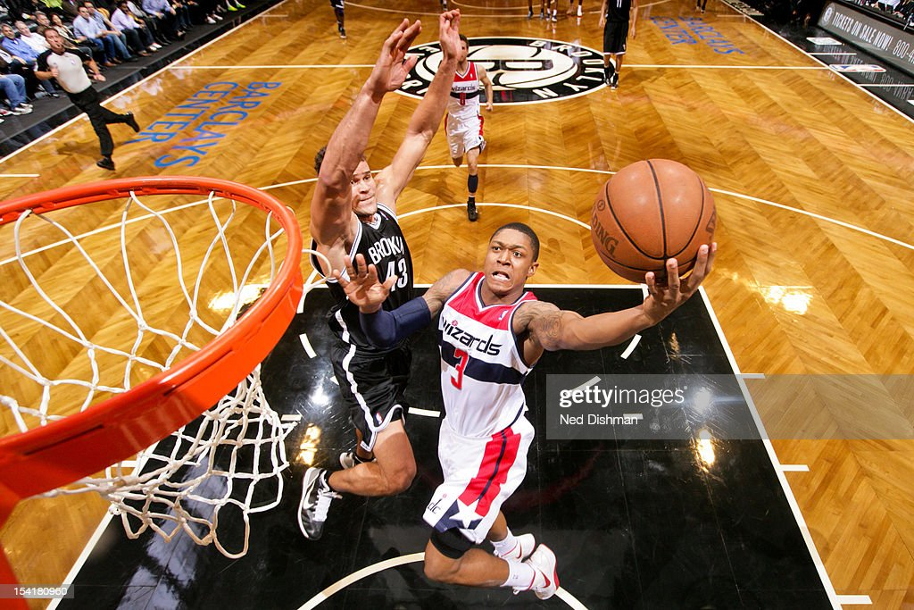 <a gi-track='captionPersonalityLinkClicked' href=/galleries/search?phrase=Bradley+Beal&family=editorial&specificpeople=7640439 ng-click='$event.stopPropagation()'>Bradley Beal</a> #3 of the Washington Wizards goes to the basket against <a gi-track='captionPersonalityLinkClicked' href=/galleries/search?phrase=Kris+Humphries&family=editorial&specificpeople=209199 ng-click='$event.stopPropagation()'>Kris Humphries</a> #43 of the Brooklyn Nets at the Barclays Center on October 15, 2012 in the Brooklyn borough of New York City.