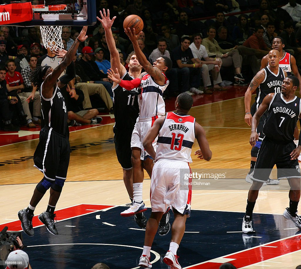 Bradley Beal #3 of the Washington Wizards goes to the basket against Brook Lopez #11 and Gerald Wallace #45 of the Brooklyn Nets during the game at the Verizon Center on January 4, 2013 in Washington, DC.