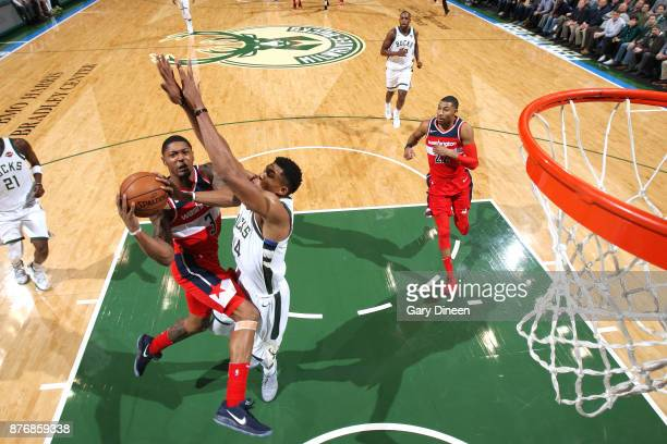 Bradley Beal of the Washington Wizards goes to the basket against Giannis Antetokounmpo of the Milwaukee Bucks on November 20 2017 at the BMO Harris...
