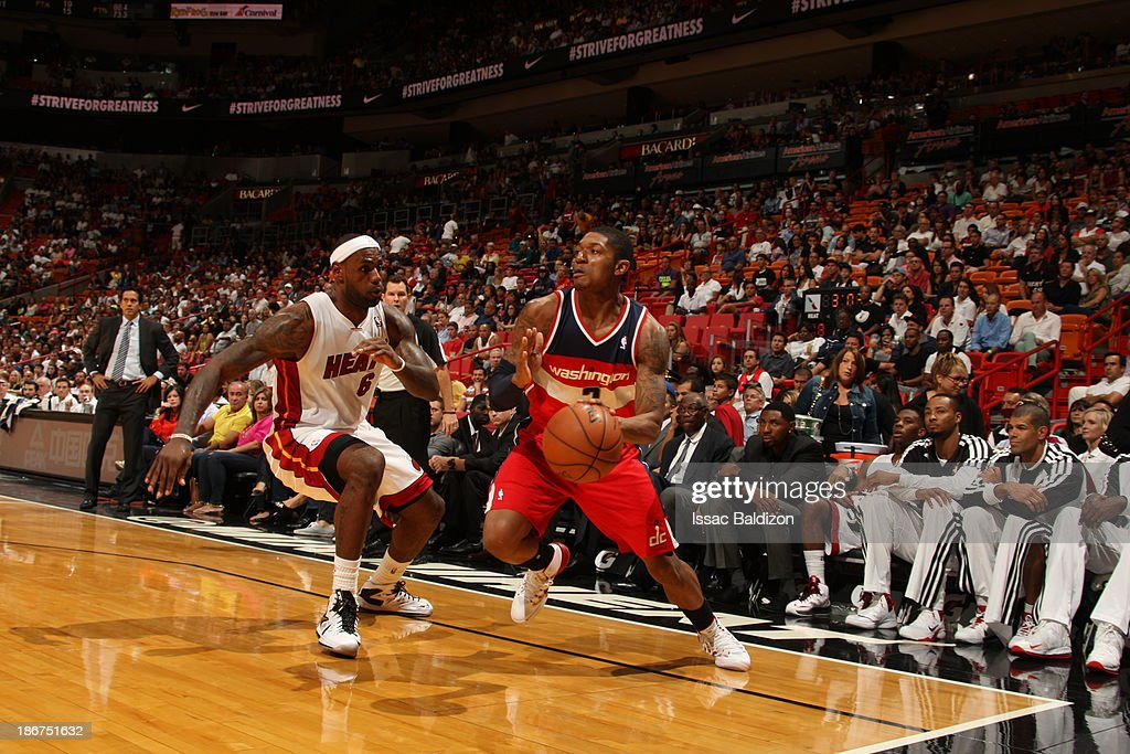 Bradley Beal #3 of the Washington Wizards handles the ball against LeBron James #6 of the Miami Heat on November 3, 2013 at American Airlines Arena in Miami, Florida.
