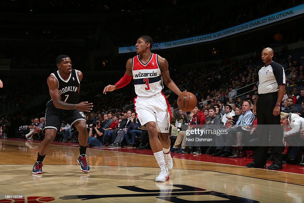 <a gi-track='captionPersonalityLinkClicked' href=/galleries/search?phrase=Bradley+Beal&family=editorial&specificpeople=7640439 ng-click='$event.stopPropagation()'>Bradley Beal</a> #3 of the Washington Wizards handles the ball against the Brooklyn Nets at the Verizon Center on November 8, 2013 in Washington, DC.