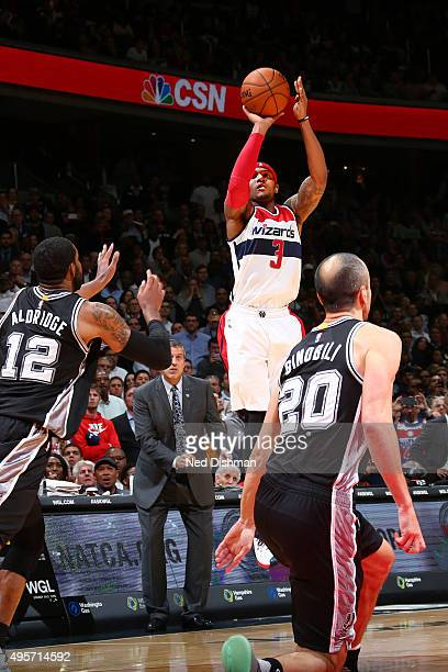 Bradley Beal of the Washington Wizards hits a three point basket as time expires to beat the San Antonio Spurs during the game on November 4 2015 at...