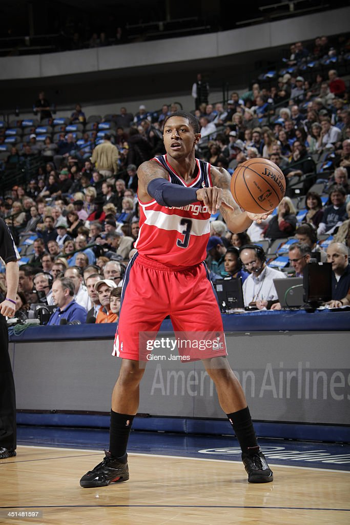 <a gi-track='captionPersonalityLinkClicked' href=/galleries/search?phrase=Bradley+Beal&family=editorial&specificpeople=7640439 ng-click='$event.stopPropagation()'>Bradley Beal</a> #3 of the Washington Wizards passes the ball against the Dallas Mavericks on November 12, 2013 at the American Airlines Center in Dallas, Texas.