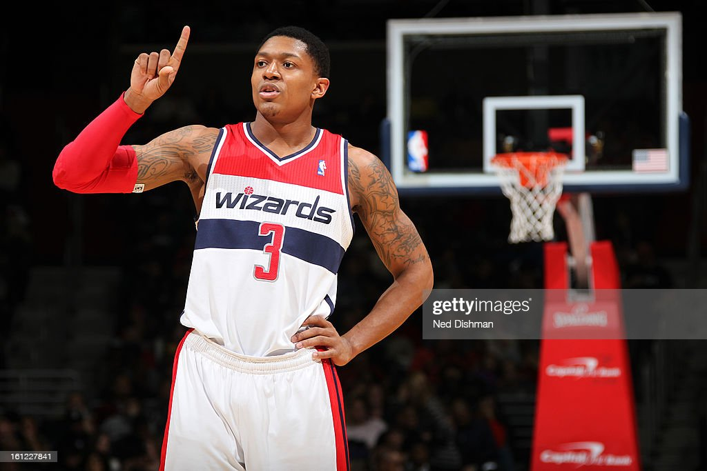 <a gi-track='captionPersonalityLinkClicked' href=/galleries/search?phrase=Bradley+Beal&family=editorial&specificpeople=7640439 ng-click='$event.stopPropagation()'>Bradley Beal</a> #3 of the Washington Wizards puts his finger after a play against the Atlanta Hawks during the game at the Verizon Center on January 12, 2013 in Washington, DC.