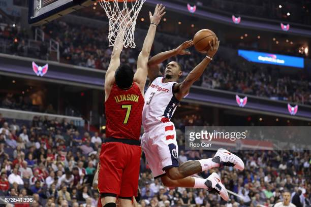 Bradley Beal of the Washington Wizards puts up a shot in front of Ersan Ilyasova of the Atlanta Hawks during the first half in Game Five of the...