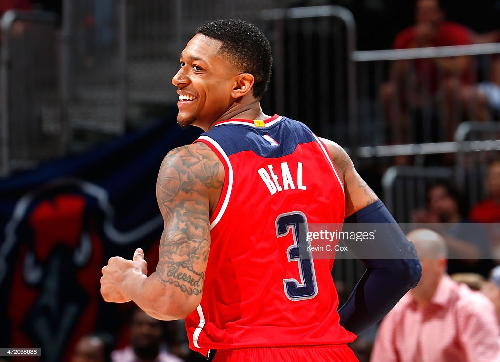<a gi-track='captionPersonalityLinkClicked' href=/galleries/search?phrase=Bradley+Beal&family=editorial&specificpeople=7640439 ng-click='$event.stopPropagation()'>Bradley Beal</a> #3 of the Washington Wizards reacts after hitting a basket against the Atlanta Hawks during Game One of the Eastern Conference Semifinals of the 2015 NBA Playoffs at Philips Arena on May 3, 2015 in Atlanta, Georgia.
