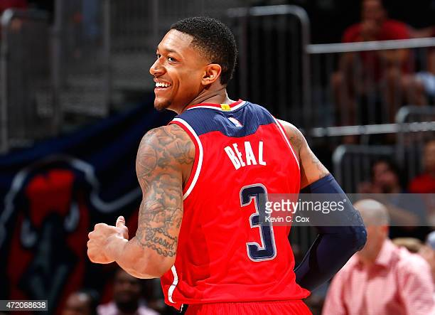 Bradley Beal of the Washington Wizards reacts after hitting a basket against the Atlanta Hawks during Game One of the Eastern Conference Semifinals...