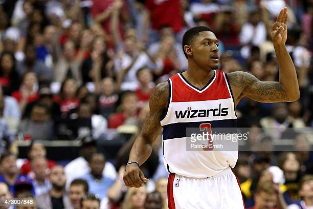 Bradley Beal of the Washington Wizards reacts after hitting a threepointer against the Atlanta Hawks during the first half in Game Four of the...
