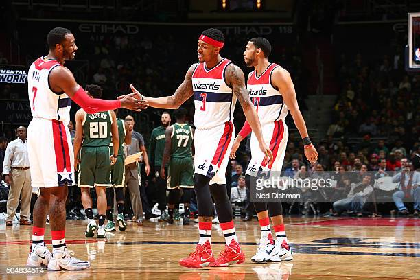 Bradley Beal of the Washington Wizards shakes hands with John Wall of the Washington Wizards during the game against the Milwaukee Bucks on January...