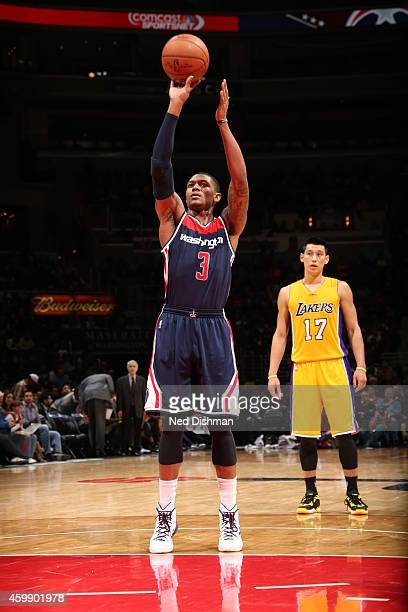Bradley Beal of the Washington Wizards shoots a free throw against the Los Angeles Lakers on December 3 2014 at the Verizon Center in Washington DC...