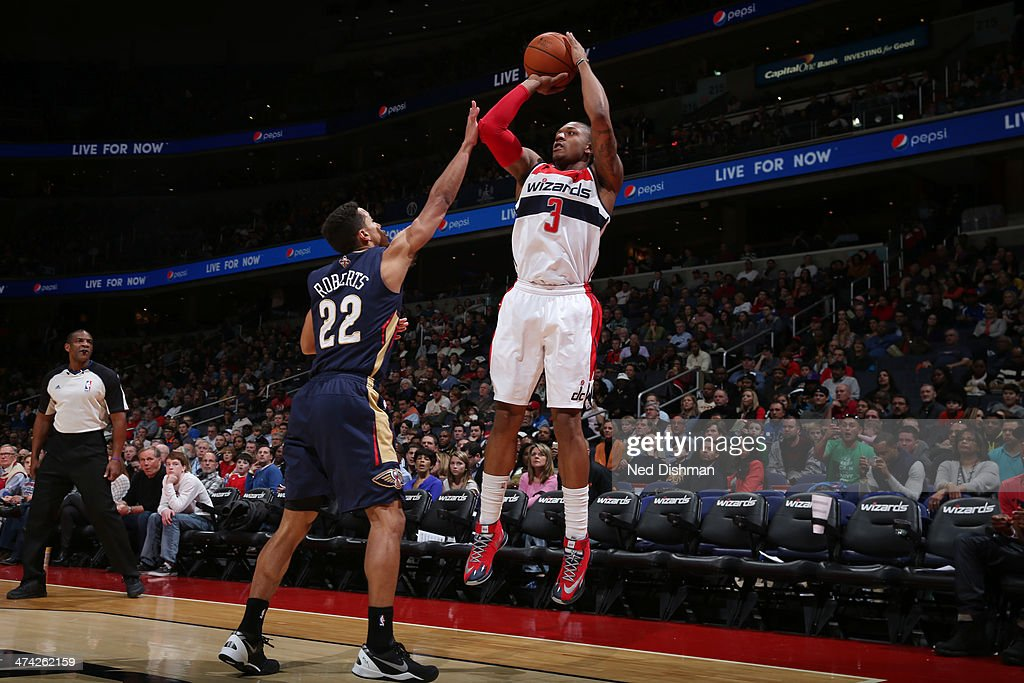 <a gi-track='captionPersonalityLinkClicked' href=/galleries/search?phrase=Bradley+Beal&family=editorial&specificpeople=7640439 ng-click='$event.stopPropagation()'>Bradley Beal</a> #3 of the Washington Wizards shoots against Brian Roberts #22 of the New Orleans Pelicans during the game at the Verizon Center on February 22, 2014 in Washington, DC.