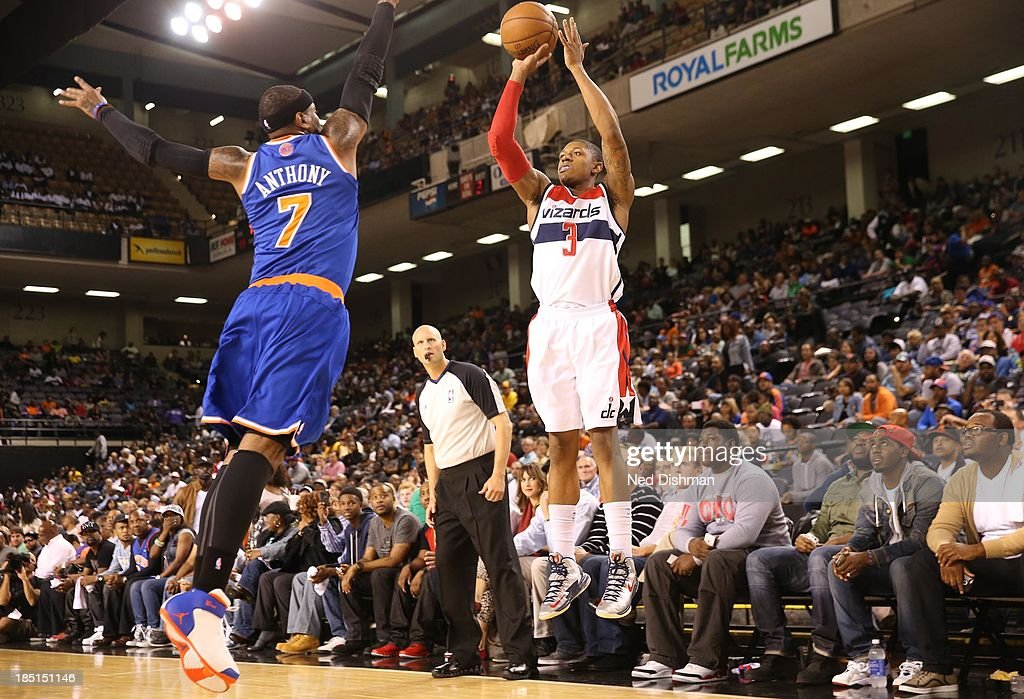 Bradley Beal #3 of the Washington Wizards shoots against Carmelo Anthony #7 of the New York Knicks during the pre-season game at the Baltimore Arena on October 17, 2013 in Baltimore, MD.