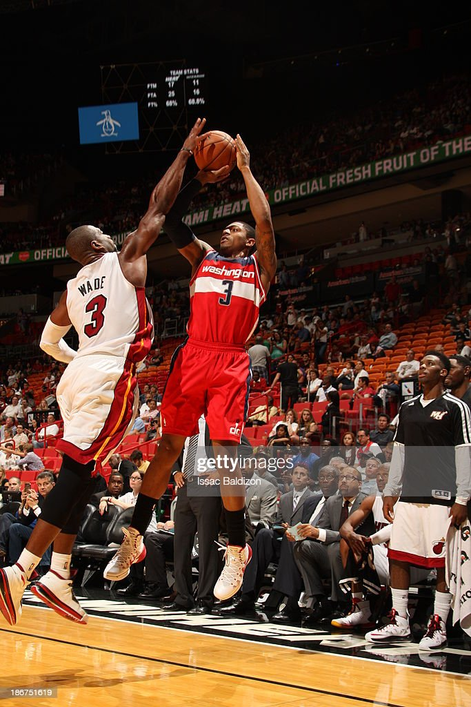 <a gi-track='captionPersonalityLinkClicked' href=/galleries/search?phrase=Bradley+Beal&family=editorial&specificpeople=7640439 ng-click='$event.stopPropagation()'>Bradley Beal</a> #3 of the Washington Wizards shoots against <a gi-track='captionPersonalityLinkClicked' href=/galleries/search?phrase=Dwyane+Wade&family=editorial&specificpeople=201481 ng-click='$event.stopPropagation()'>Dwyane Wade</a> #3 of the Miami Heat on November 3, 2013 at American Airlines Arena in Miami, Florida.
