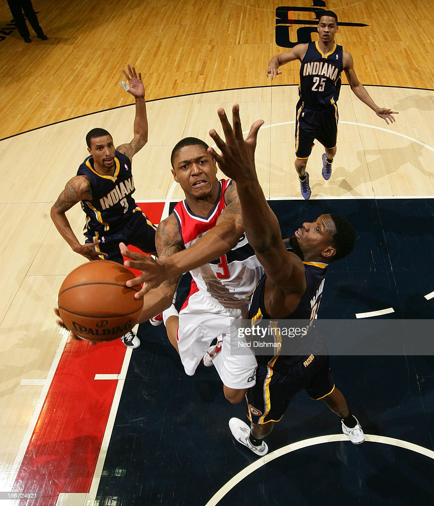 <a gi-track='captionPersonalityLinkClicked' href=/galleries/search?phrase=Bradley+Beal&family=editorial&specificpeople=7640439 ng-click='$event.stopPropagation()'>Bradley Beal</a> #3 of the Washington Wizards shoots against <a gi-track='captionPersonalityLinkClicked' href=/galleries/search?phrase=Ian+Mahinmi&family=editorial&specificpeople=740196 ng-click='$event.stopPropagation()'>Ian Mahinmi</a> #28 of the Indiana Pacers during the game at the Verizon Center on November 19, 2012 in Washington, DC.