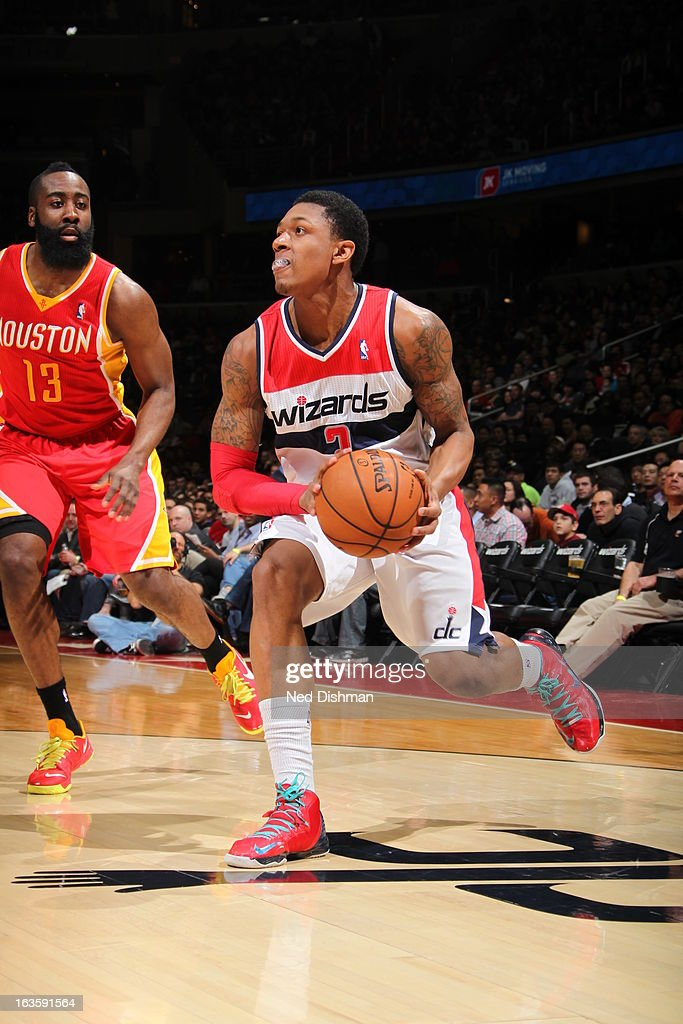 <a gi-track='captionPersonalityLinkClicked' href=/galleries/search?phrase=Bradley+Beal&family=editorial&specificpeople=7640439 ng-click='$event.stopPropagation()'>Bradley Beal</a> #3 of the Washington Wizards shoots against <a gi-track='captionPersonalityLinkClicked' href=/galleries/search?phrase=James+Harden&family=editorial&specificpeople=4215938 ng-click='$event.stopPropagation()'>James Harden</a> #13 of the Houston Rockets during the game at the Verizon Center on February 23, 2013 in Washington, DC.