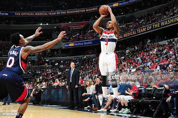 Bradley Beal of the Washington Wizards shoots against Jeff Teague of the Atlanta Hawks in Game Six of the Eastern Conference Semifinals during the...