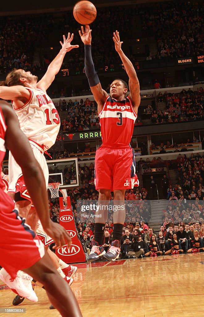 Bradley Beal #3 of the Washington Wizards shoots against Joakim Noah #13 of the Chicago Bulls on December 29, 2012 at the United Center in Chicago, Illinois.