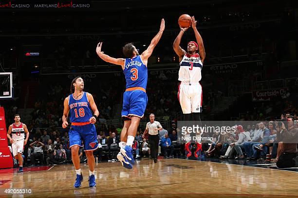 Bradley Beal of the Washington Wizards shoots against Jose Calderon of the New York Knicks during a preseason game on October 9 2015 at Verizon...