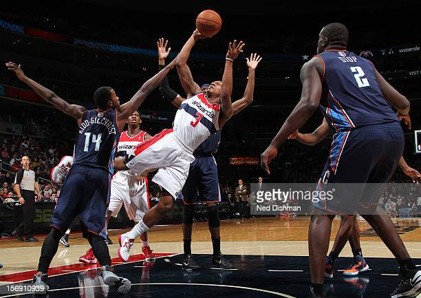 Bradley Beal of the Washington Wizards shoots against Michael KiddGilchrist of the Charlotte Bobcats during the game at the Verizon Center on...