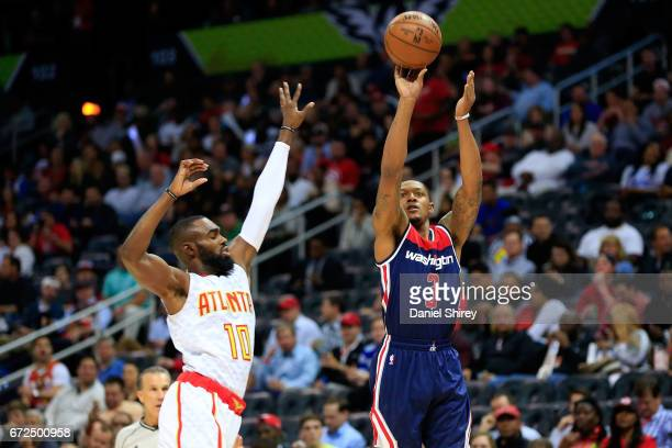 Bradley Beal of the Washington Wizards shoots against Tim Hardaway Jr #10 of the Atlanta Hawks during the first quarter in Game Four of the Eastern...