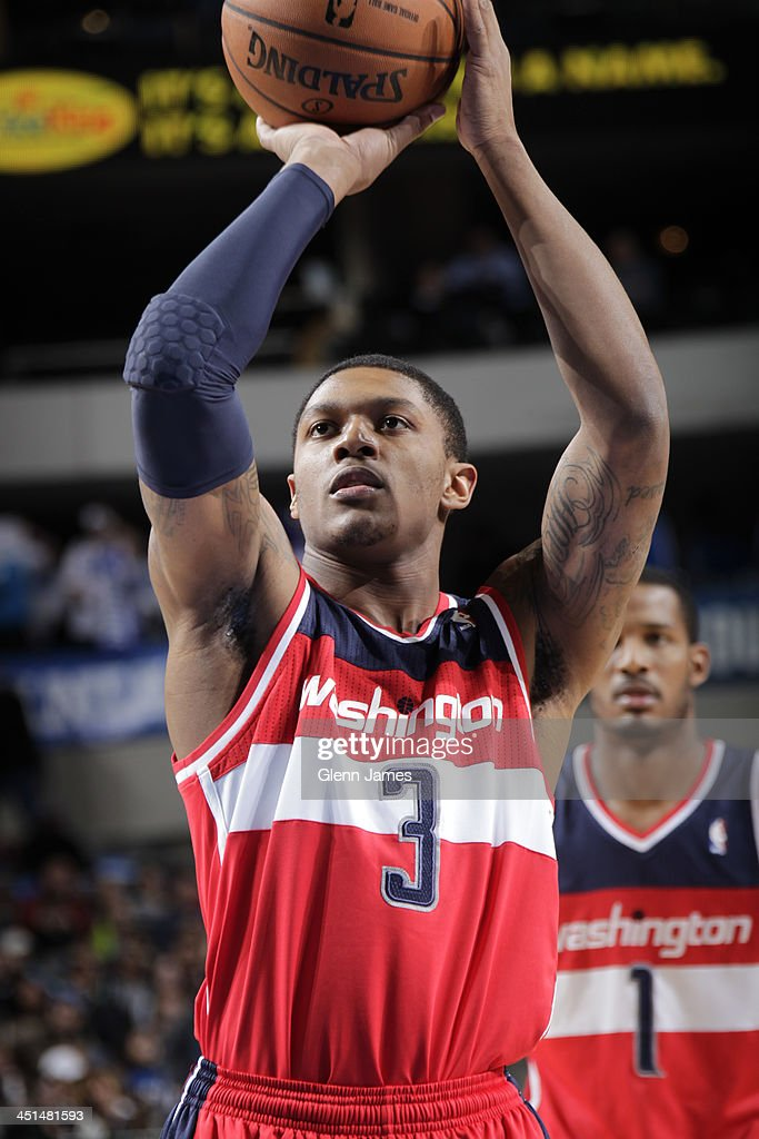 <a gi-track='captionPersonalityLinkClicked' href=/galleries/search?phrase=Bradley+Beal&family=editorial&specificpeople=7640439 ng-click='$event.stopPropagation()'>Bradley Beal</a> #3 of the Washington Wizards shoots the ball against the Dallas Mavericks on November 12, 2013 at the American Airlines Center in Dallas, Texas.