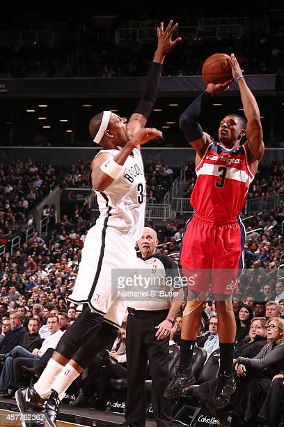Bradley Beal of the Washington Wizards shoots the ball against the Brooklyn Nets on December 18 2013 in the Brooklyn borough of New York City NOTE TO...