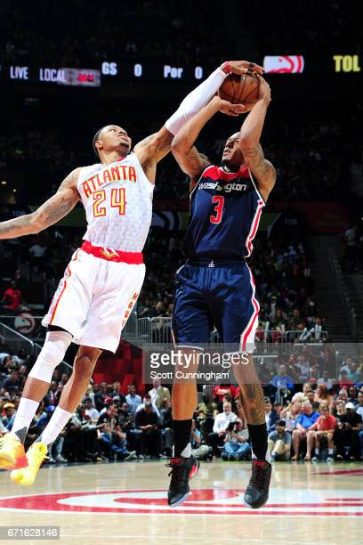 Bradley Beal of the Washington Wizards shoots the ball and gets blocked by Kent Bazemore of the Atlanta Hawks in Game Four of the Eastern Conference...