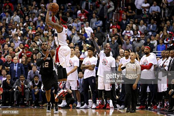 Bradley Beal of the Washington Wizards shoots the gamewinning shot over LaMarcus Aldridge of the San Antonio Spurs in the fourth quarter at Verizon...