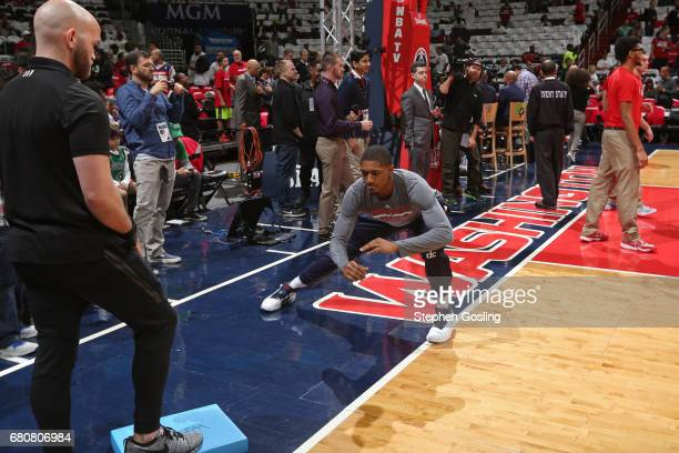 Bradley Beal of the Washington Wizards stretches on the court before Game Four of the Eastern Conference Semifinals against the Boston Celtics during...