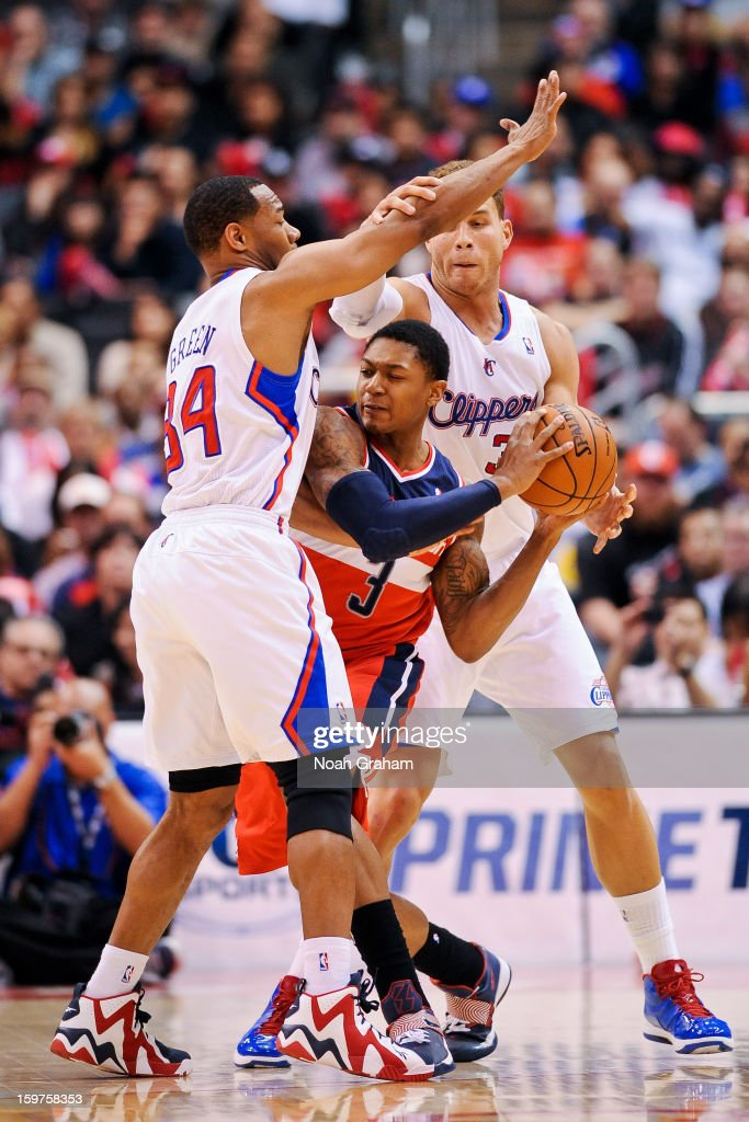 Bradley Beal #3 of the Washington Wizards tries to pass the ball against Willie Green #34 and Blake Griffin #32 of the Los Angeles Clippers at Staples Center on January 19, 2013 in Los Angeles, California.