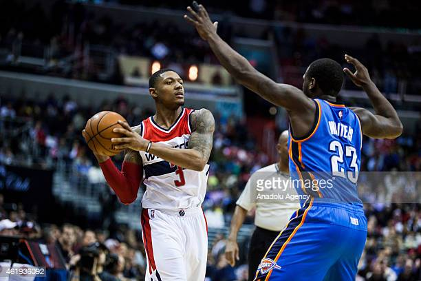 Bradley Beal of Washington Wizard in action against Dion Waiters of Oklahoma City Thunders during an NBA game at the Verizon Center in Washington USA...