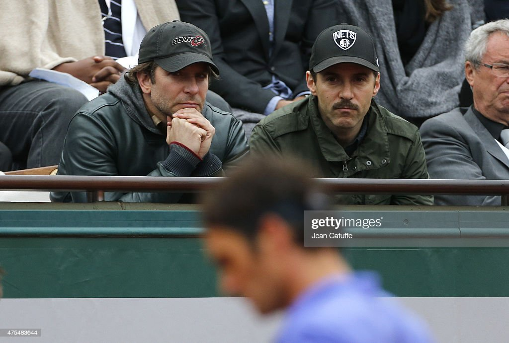 Bradley Cooper and Alessandro Nivola cheer for Roger Federer of Switzerland during his match on Center Court on day 8 of the French Open 2015 at Roland Garros stadium on May 31, 2015 in Paris, France.