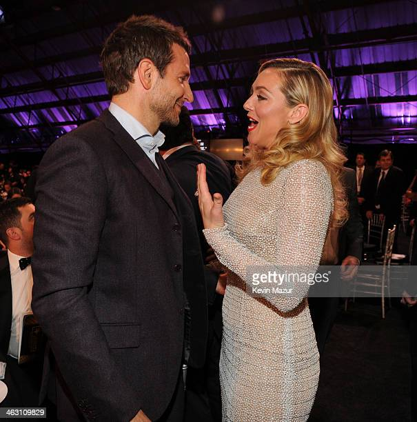 Bradley Cooper and Elisabeth Rohm attend the19th Annual Critics' Choice Movie Awards at Barker Hangar on January 16 2014 in Santa Monica California