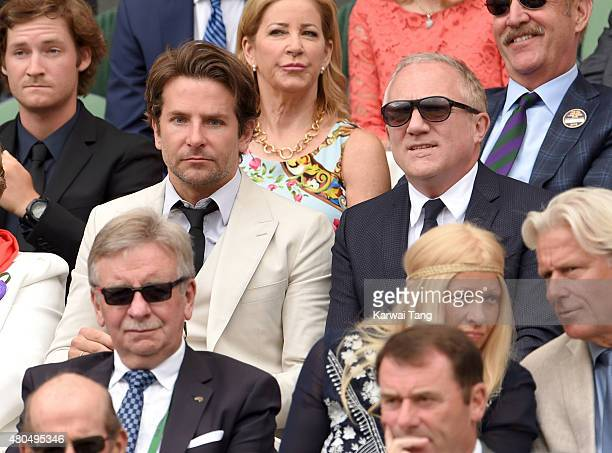 Bradley Cooper and FrancoisHenri Pinault attend day 13 of the Wimbledon Tennis Championships at Wimbledon on July 12 2015 in London England