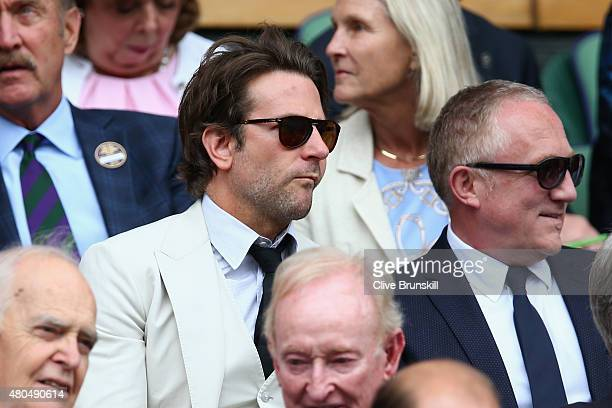 Bradley Cooper and FrancoisHenri Pinault attend day thirteen of the Wimbledon Lawn Tennis Championships at the All England Lawn Tennis and Croquet...