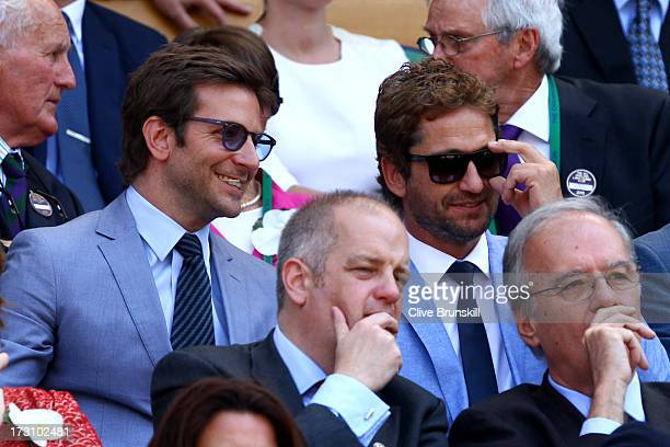 Bradley Cooper and Gerard Butler attend the Gentlemen's Singles Final match between Andy Murray of Great Britain and Novak Djokovic of Serbia on day...
