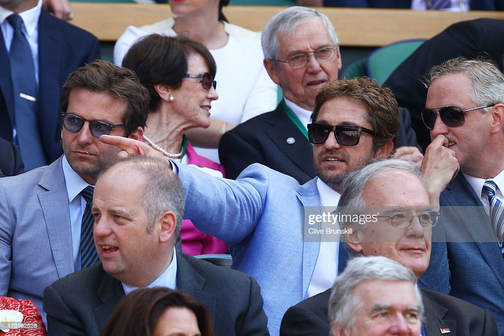 Bradley Cooper and Gerard Butler attend the Gentlemen's Singles Final match between Andy Murray of Great Britain and Novak Djokovic of Serbia on day thirteen of the Wimbledon Lawn Tennis Championships at the All England Lawn Tennis and Croquet Club on July 7, 2013 in London, England.