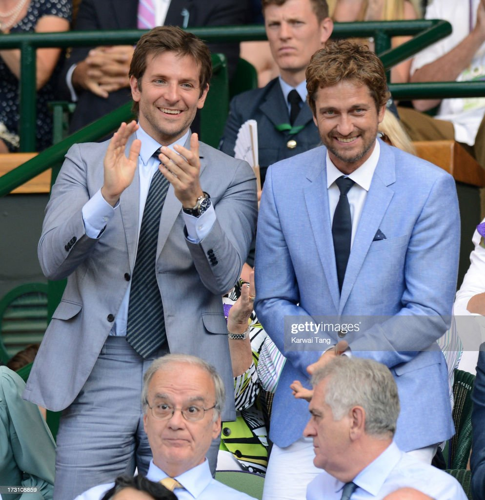 Bradley Cooper and Gerard Butler attend the Men's Singles Final between Novak Djokovic and Andy Murray on Day 13 of the Wimbledon Lawn Tennis...