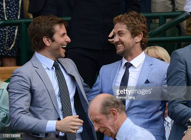 Bradley Cooper and Gerard Butler attend the Mens Singles Final on Day 13 of the Wimbledon Lawn Tennis Championships at the All England Lawn Tennis...