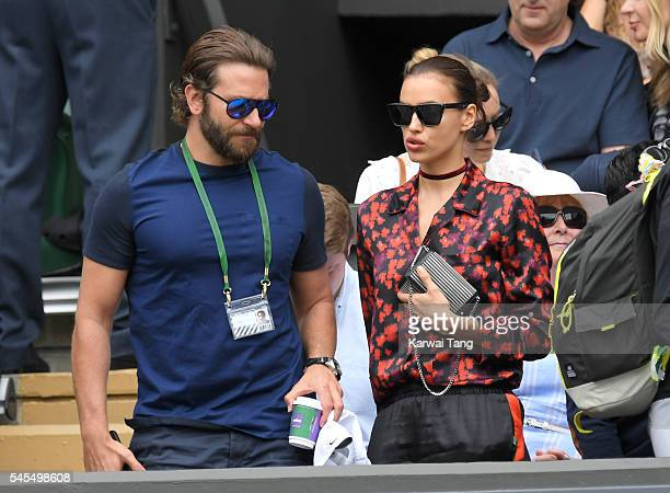 Bradley Cooper and Irina Shayk attend day eleven of the Wimbledon Tennis Championships at Wimbledon on July 08 2016 in London England