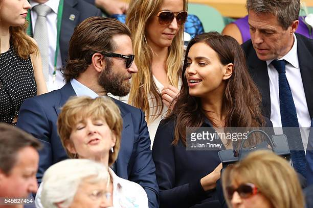 Bradley Cooper and Irina Shayk look on prior to the Men's Singles Final match between Andy Murray of Great Britain and Milos Raonic of Canada on day...