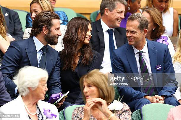 Bradley Cooper and Irina Shayk speak to Stefan Edberg prior to the Men's Singles Final match between Andy Murray of Great Britain and Milos Raonic of...