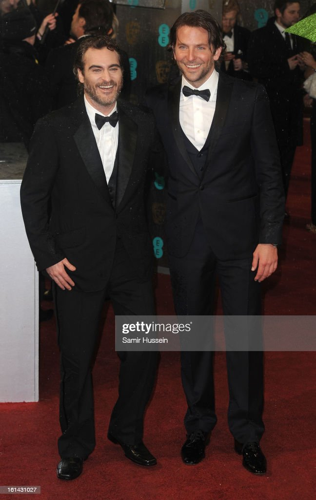 Bradley Cooper (R) and Joaquin Phoenix attend the EE British Academy Film Awards at The Royal Opera House on February 10, 2013 in London, England.