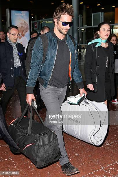 Bradley Cooper arrives at Paris Charles de Gaulle airport on March 2 2016 in Paris France
