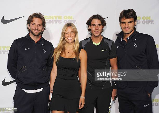 Bradley Cooper Bar Refaeli Rafael Nadal and Roger Federer attend the 2010 unveiling of the US Open Nike designs at Pier 54 on August 25 2010 in New...