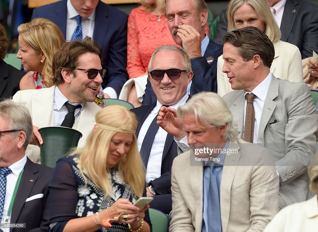 Bradley Cooper, Francois-Henri Pinault and Hugh Grant attend day 13 of the Wimbledon Tennis Championships at Wimbledon on July 12, 2015 in London, England.